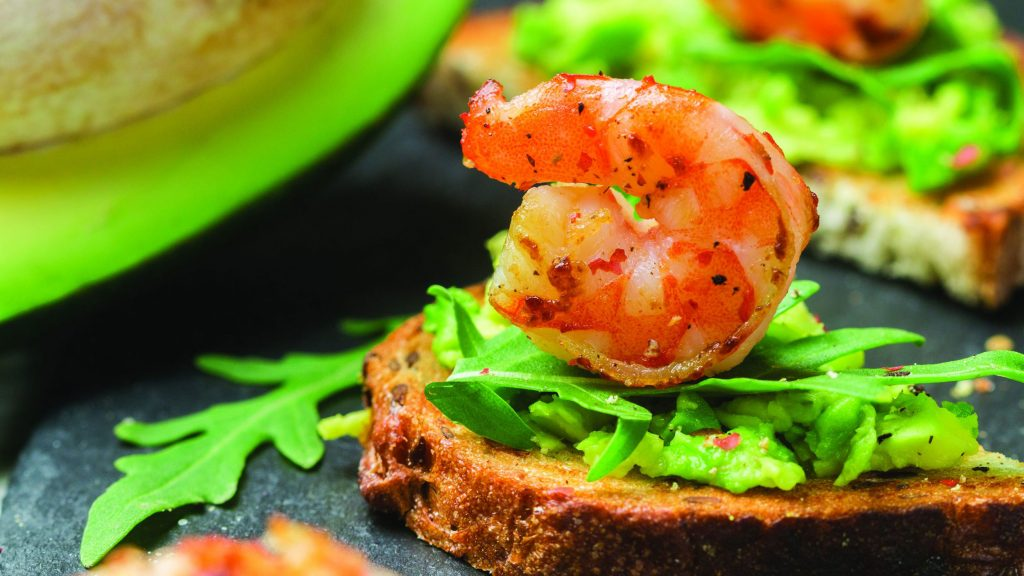 A catered appetizer made from shrimp and toasted bread.